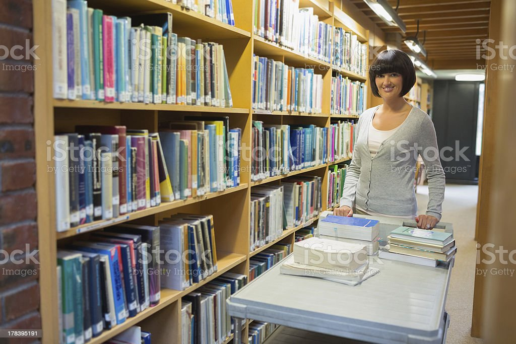 Librarian putting books stock photo