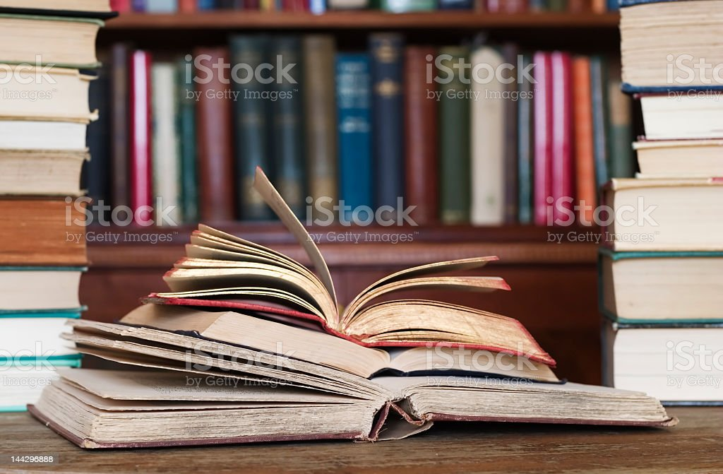 Library books opened and stacked on top of each other stock photo