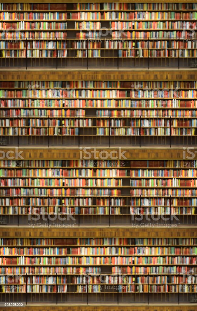 Library bookshelf off focus, background stock photo