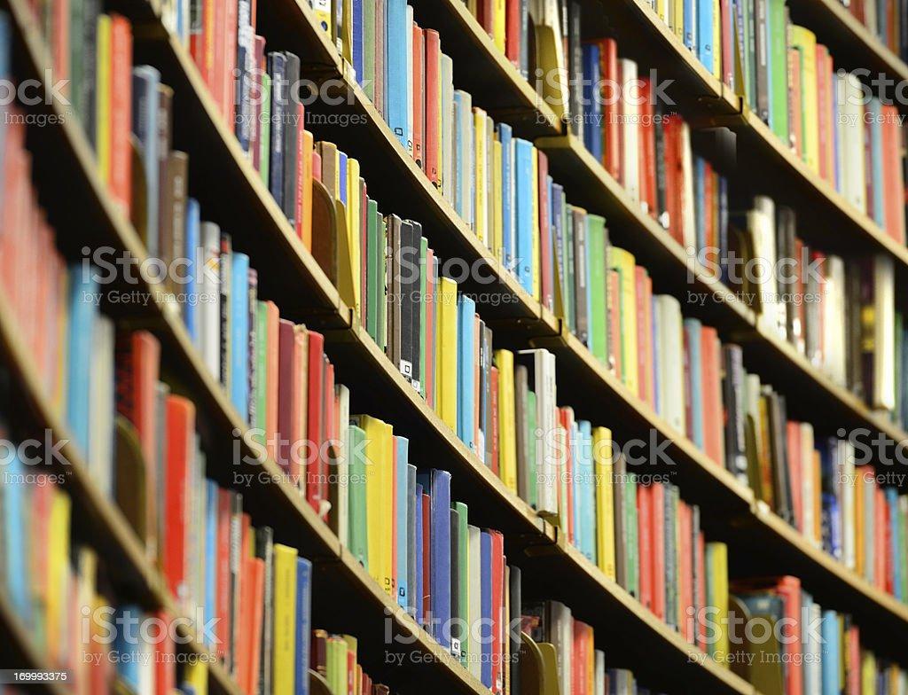 Library bookshelf, shallow DOF stock photo