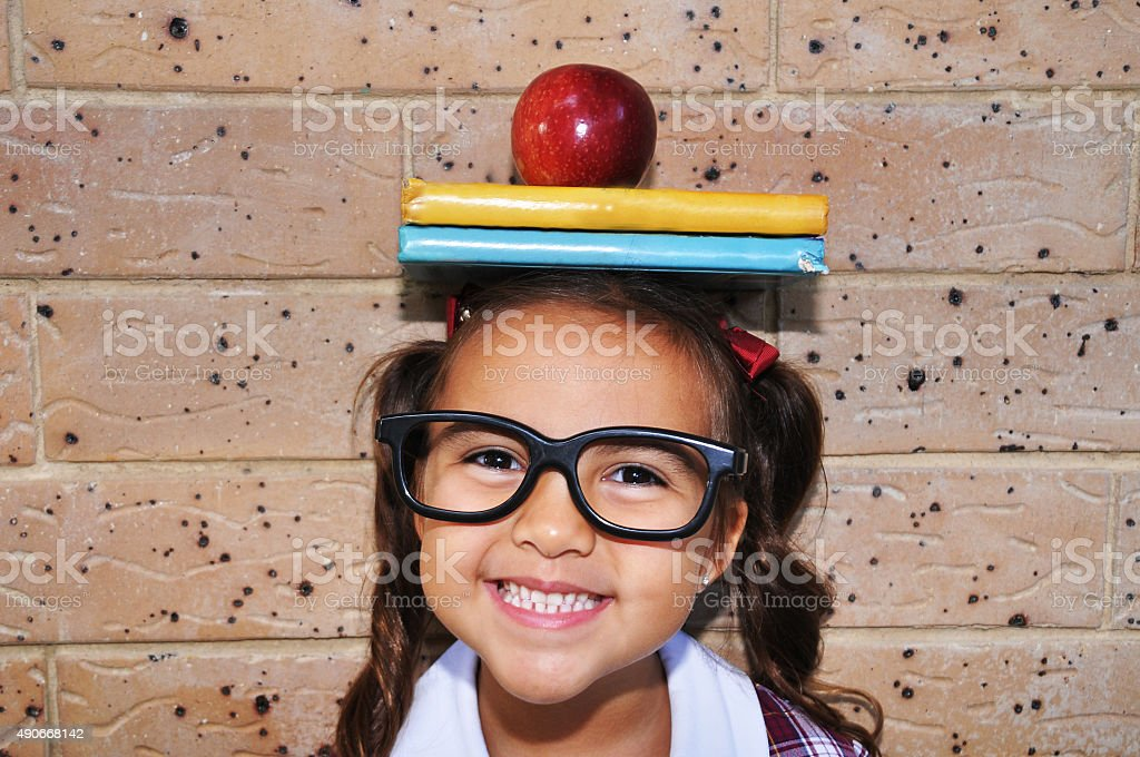 Library Geek with books on head. stock photo