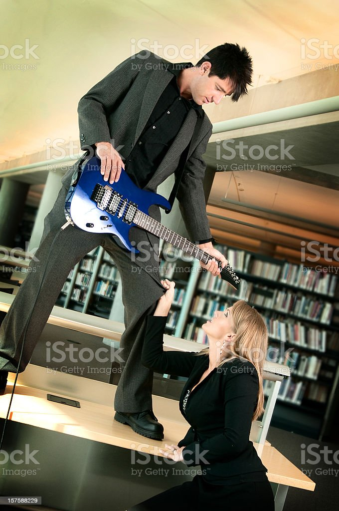Library Guitarist and Groupie royalty-free stock photo