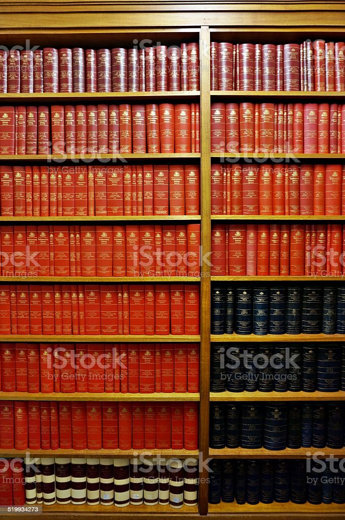 Library shelves full of old books stock photo