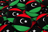Libya Badges Background - Pile of Libyan Flag Buttons