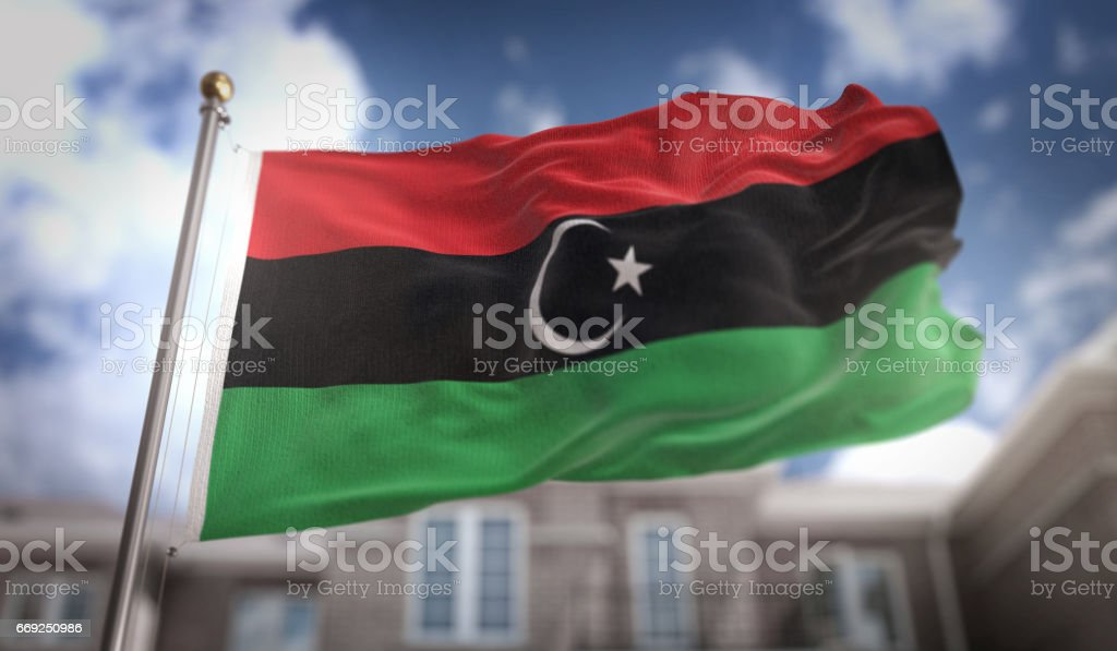 Libya Flag 3D Rendering on Blue Sky Building Background stock photo