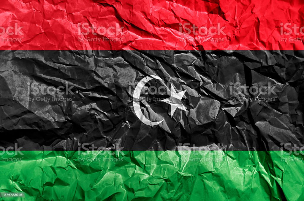 Libya flag painted on crumpled paper background stock photo