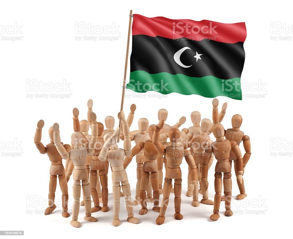Libya  Kingdom - wooden mannequin group with flag stock photo