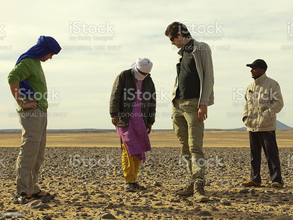 Libyan men waiting in the Sahara desert royalty-free stock photo