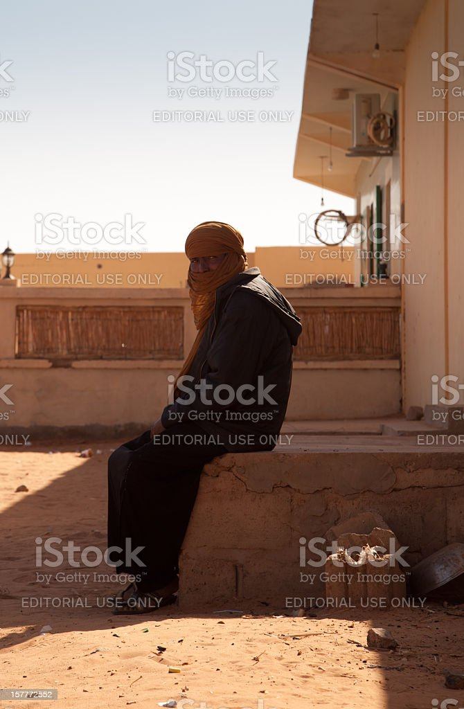 Libyan resident sitting outside watching traffic in Sabha, Libya royalty-free stock photo
