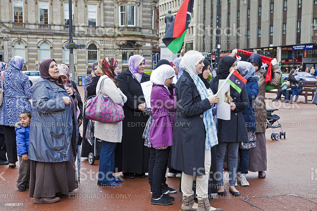 Libyan women and supporters at an anti-Gaddafi demonstration; Glasgow royalty-free stock photo