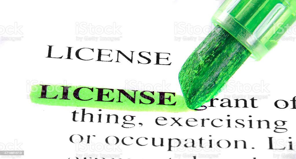 license definition highligted in dictionary stock photo