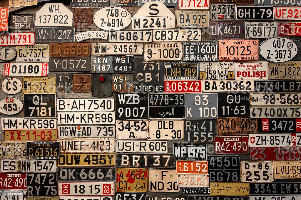 License Plates on the wall stock photo