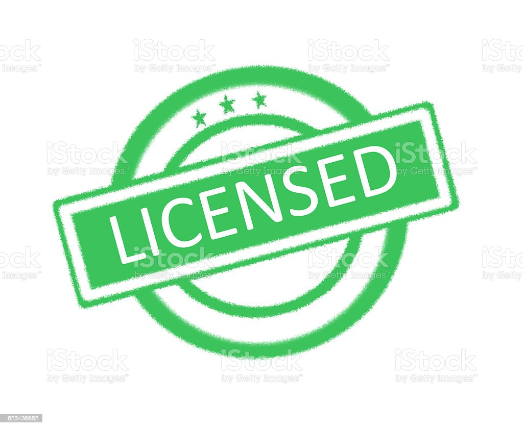 Licensed word on rubber stamp stock photo