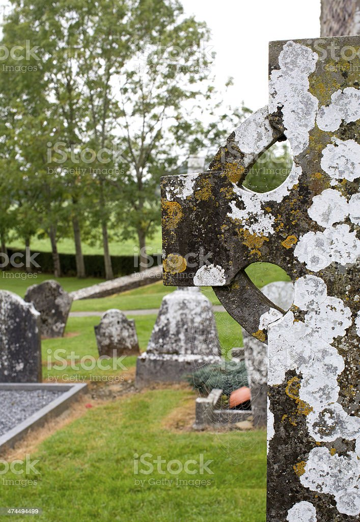 Lichen covered Celtic cross royalty-free stock photo