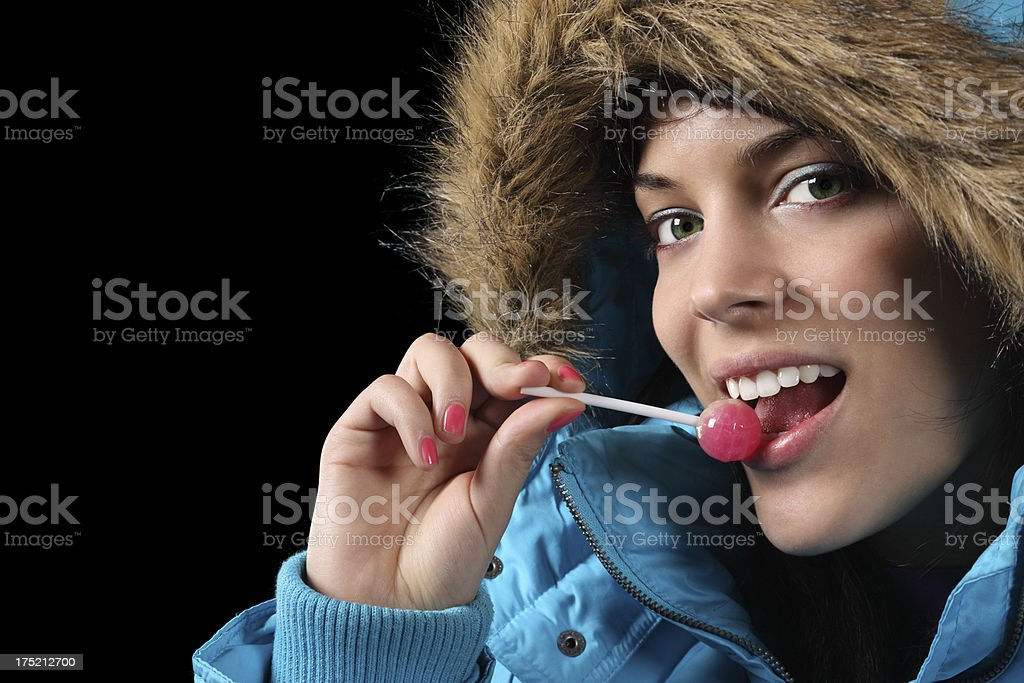 Licking a lollypop royalty-free stock photo
