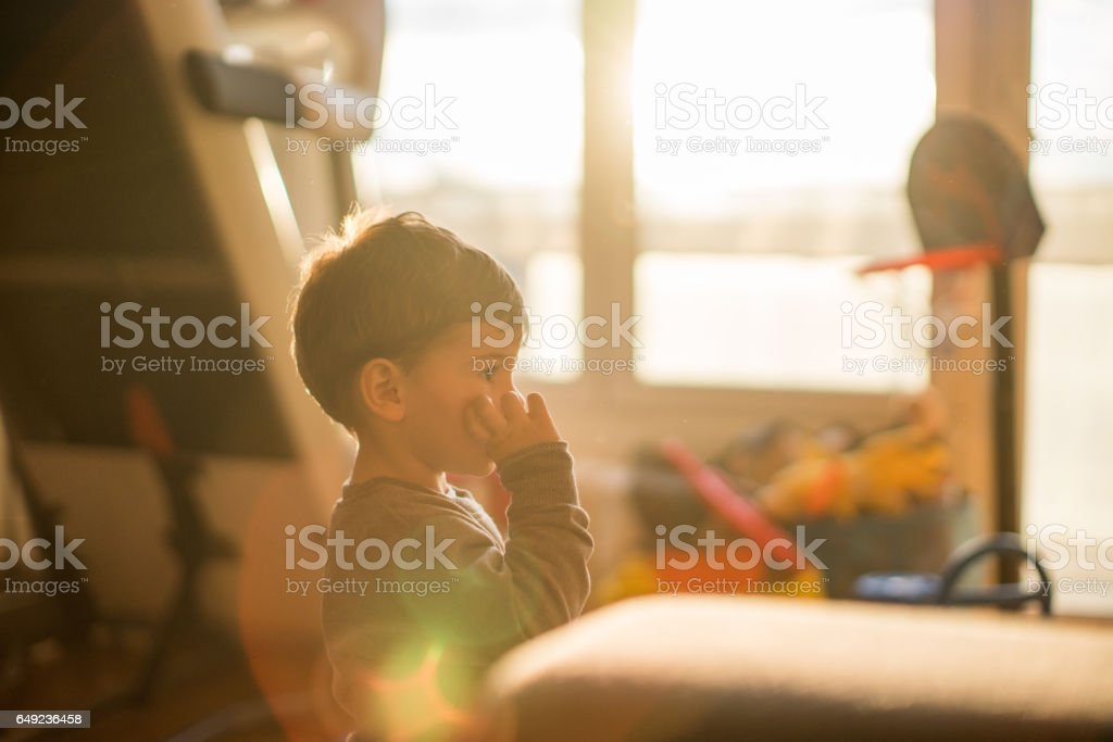 Licking fingers stock photo