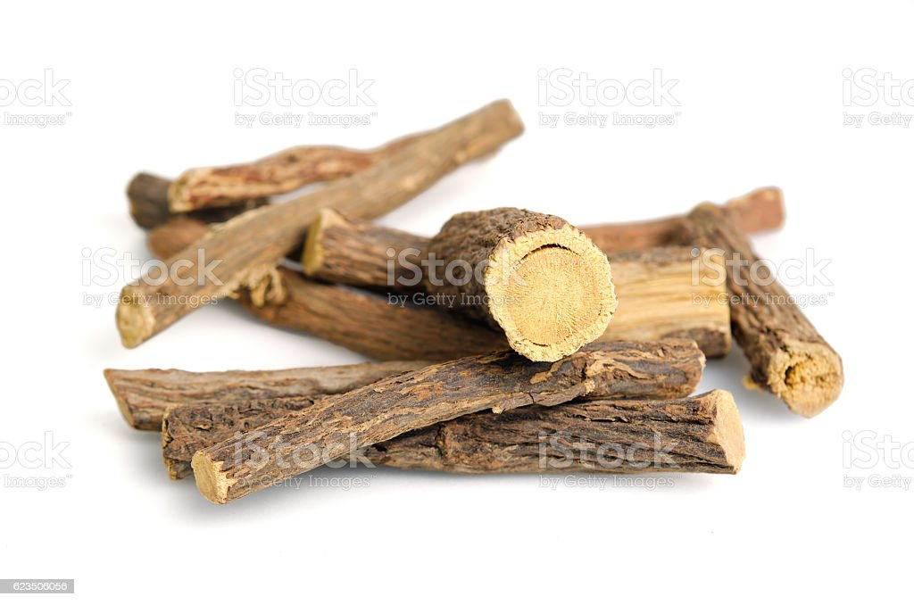 Licorice or liquorice root sticks isolated on white background stock photo