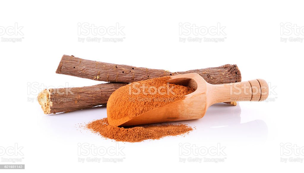 Licorice roots and Cinnamon powder on white background. stock photo