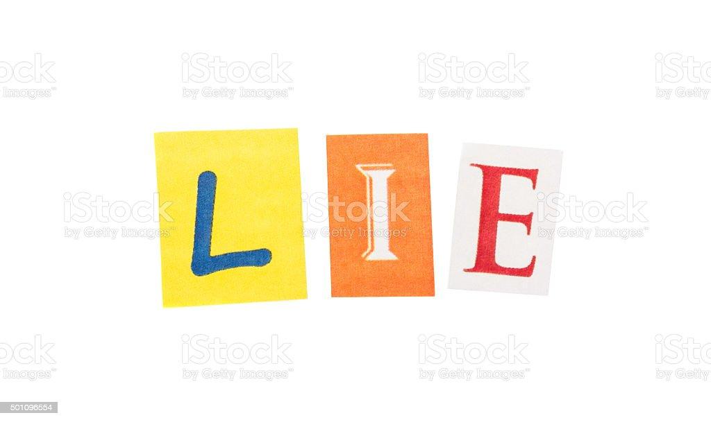 Lie cut out letters inscription stock photo