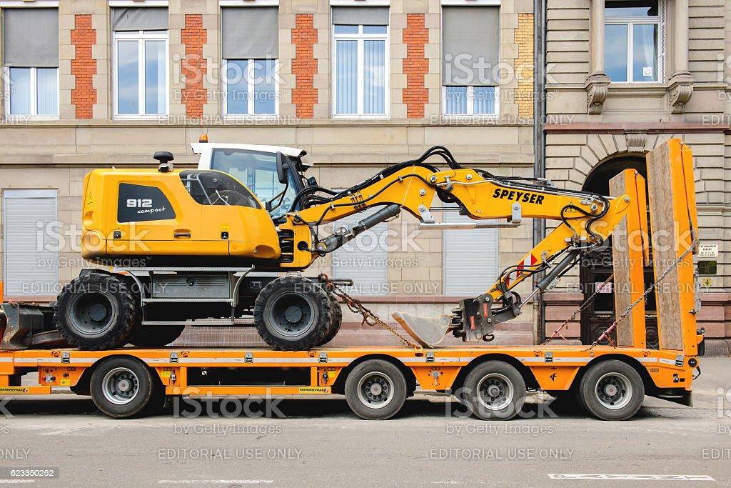 Liebherr 912 compact excavator on transportation trailer stock photo