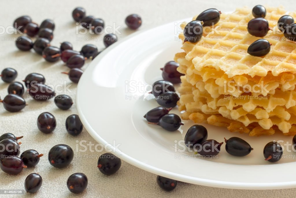 Liege waffles with berries on a napkin stock photo