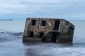 Liepaja beach bunker. Abandoned military ruins. Brick house, soft water.