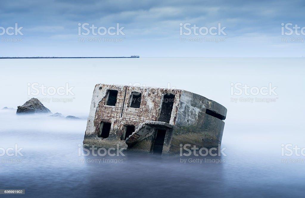 Liepaja beach bunker. Abandoned military ruins. Brick house, soft water. stock photo