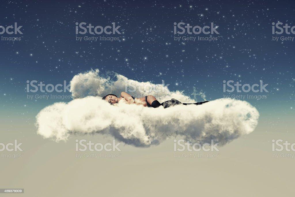 lies on a cloud stock photo