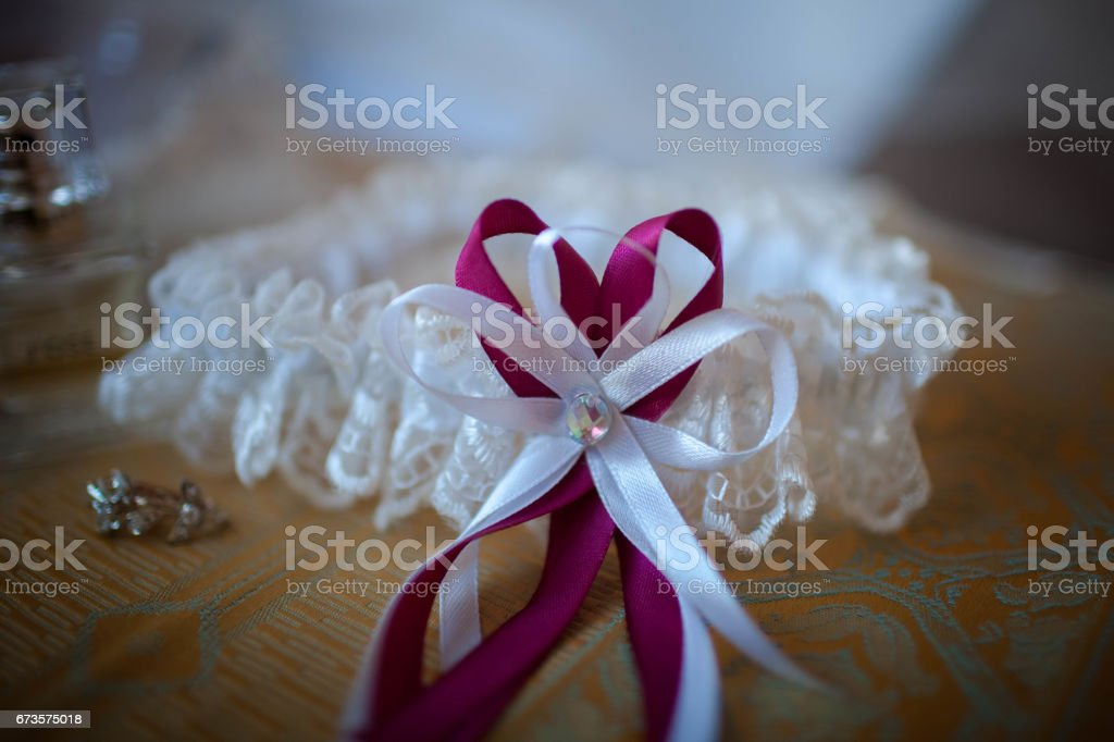 lies white wedding lace garter stock photo