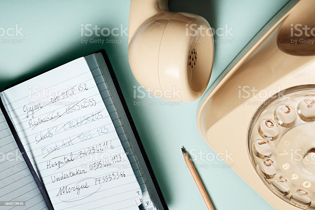 Life and death on the phone book stock photo