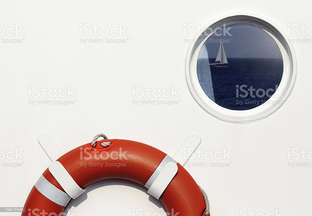 Life belt and porthole royalty-free stock photo