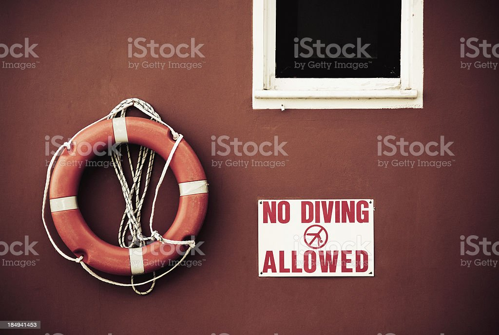 Life belt with no diving sign stock photo