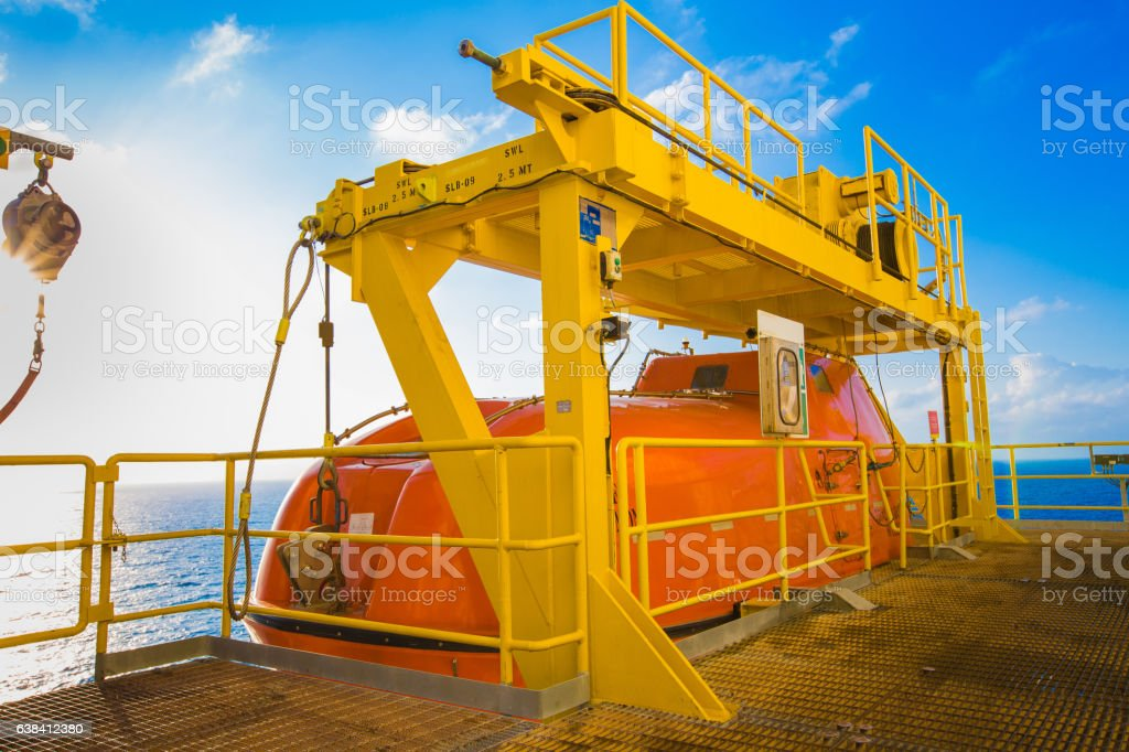 Life boat or survival craft at muster station. stock photo