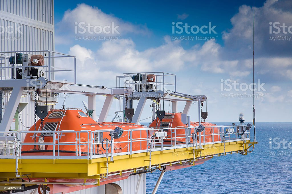 Life boat use in emergency at oil rig,platform. stock photo