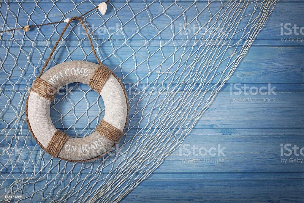 Life buoy and netting on blue background stock photo