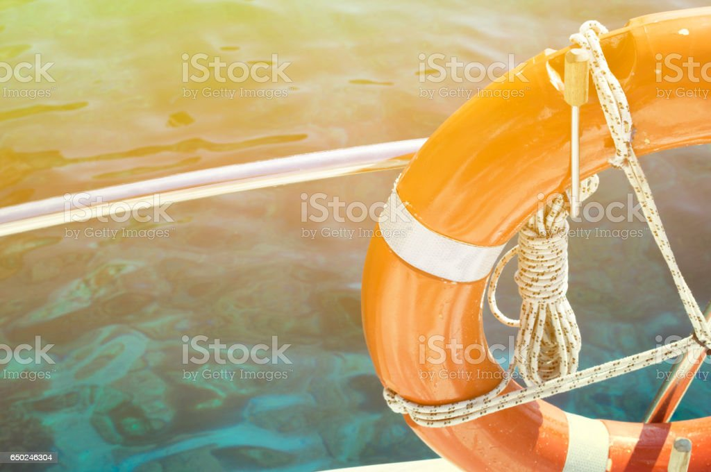 Life buoy attached to the cruise ship stock photo