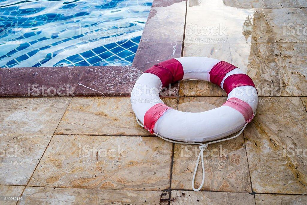 Life buoy beside swimming pool stock photo