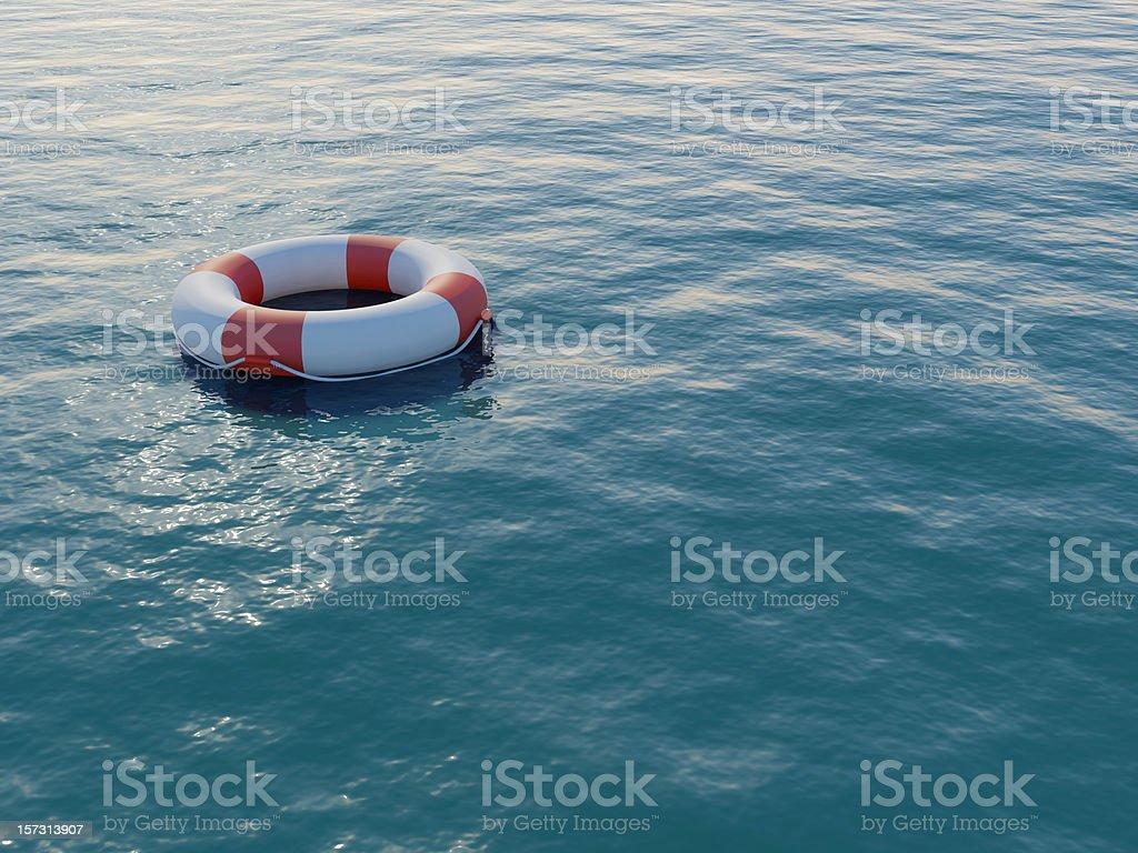 Life buoy floating on a rippled sea stock photo