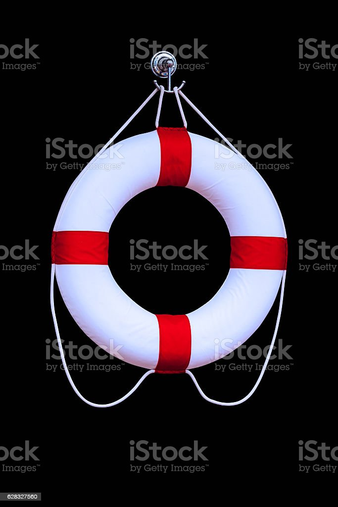 Life buoy hanging in isolated on black stock photo