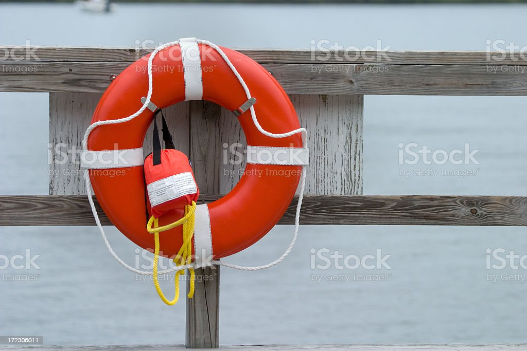 Life Buoy Hanging on a Dock royalty-free stock photo