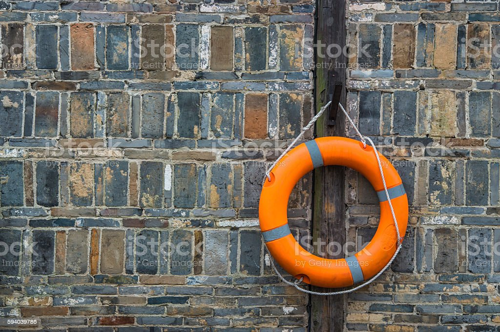 Life buoy hanging on the wall stock photo
