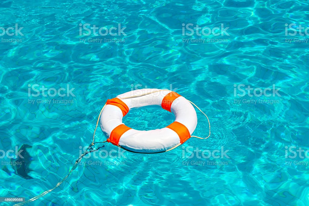 Life buoy in swimming pool stock photo