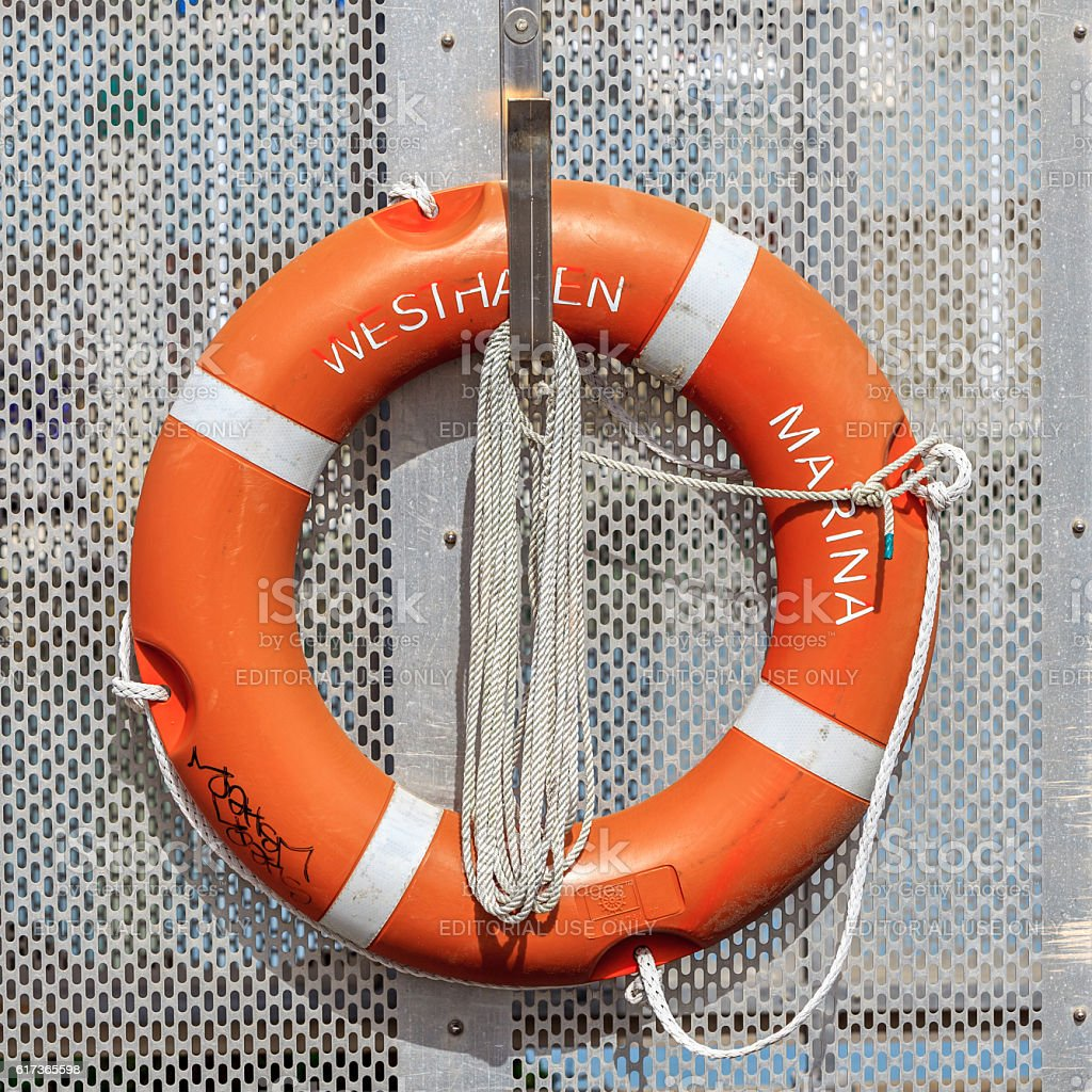 Auckland, New Zealand- December 10, 2013. Life buoy is hanged. stock photo
