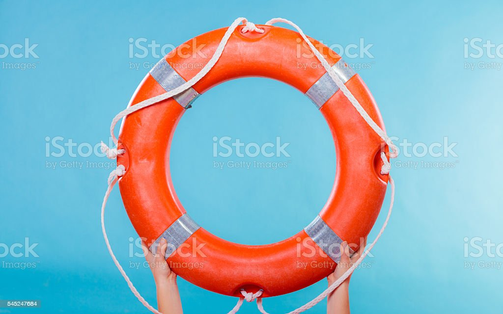 Life buoy ring in female hands stock photo