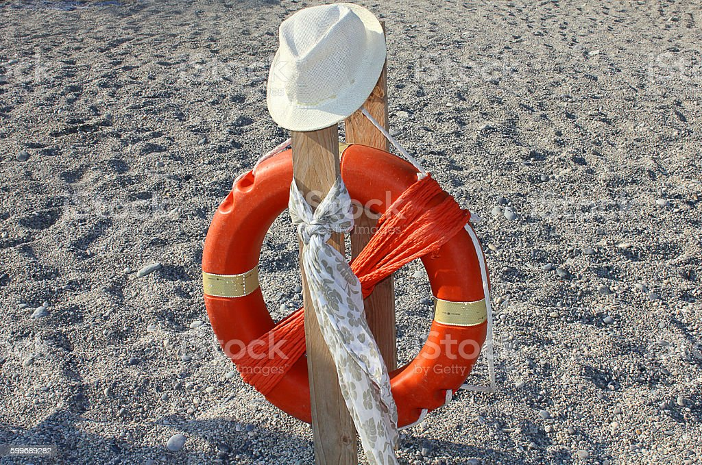 life buoy with hat and scarf stock photo