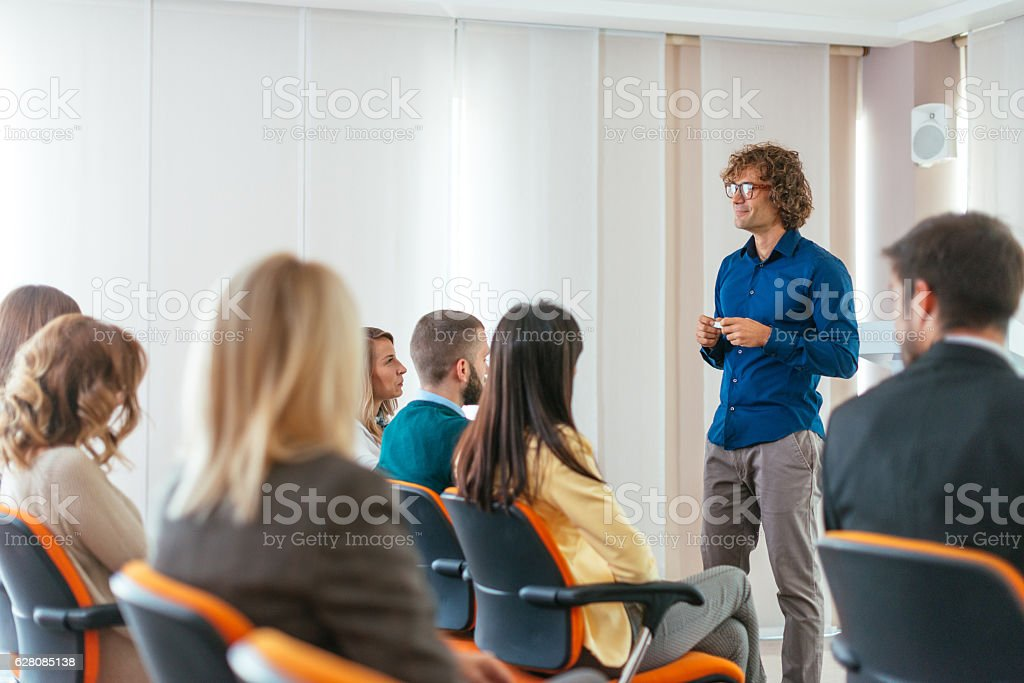 Image of large or medium group of people sitting in conference hall,...
