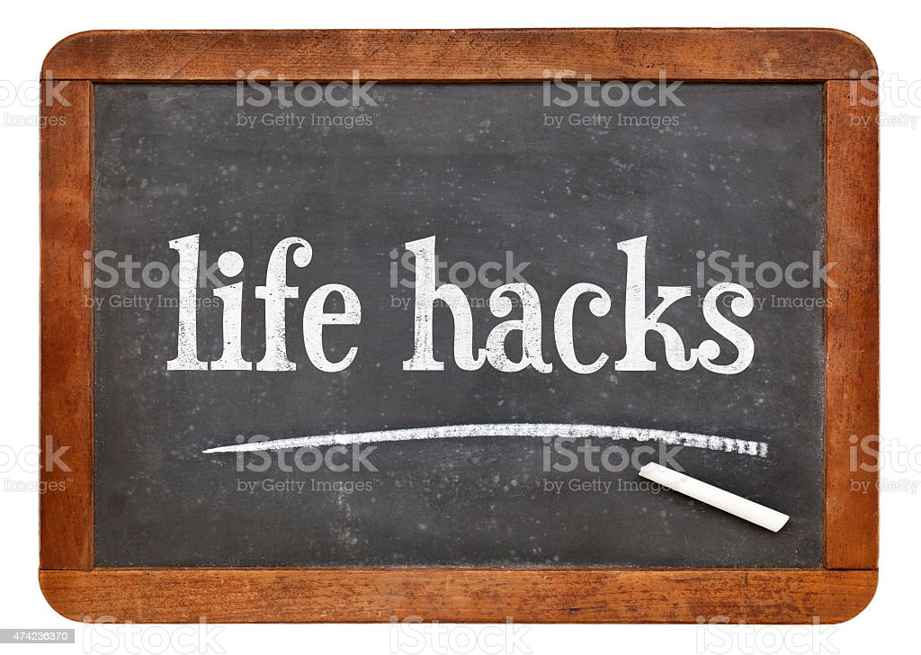 life hacks on balckboard stock photo