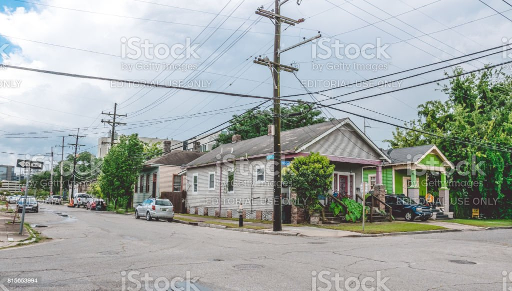Life in the old poor neighborhood of New Orleans. Worn cars and old houses stock photo