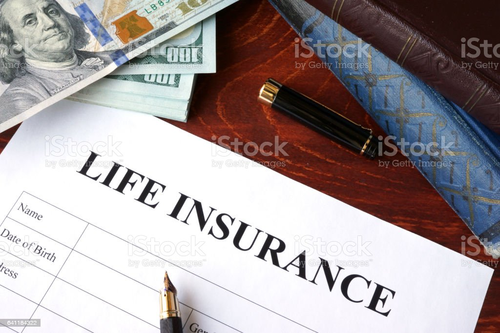 Life insurance policy and currency on a table. stock photo