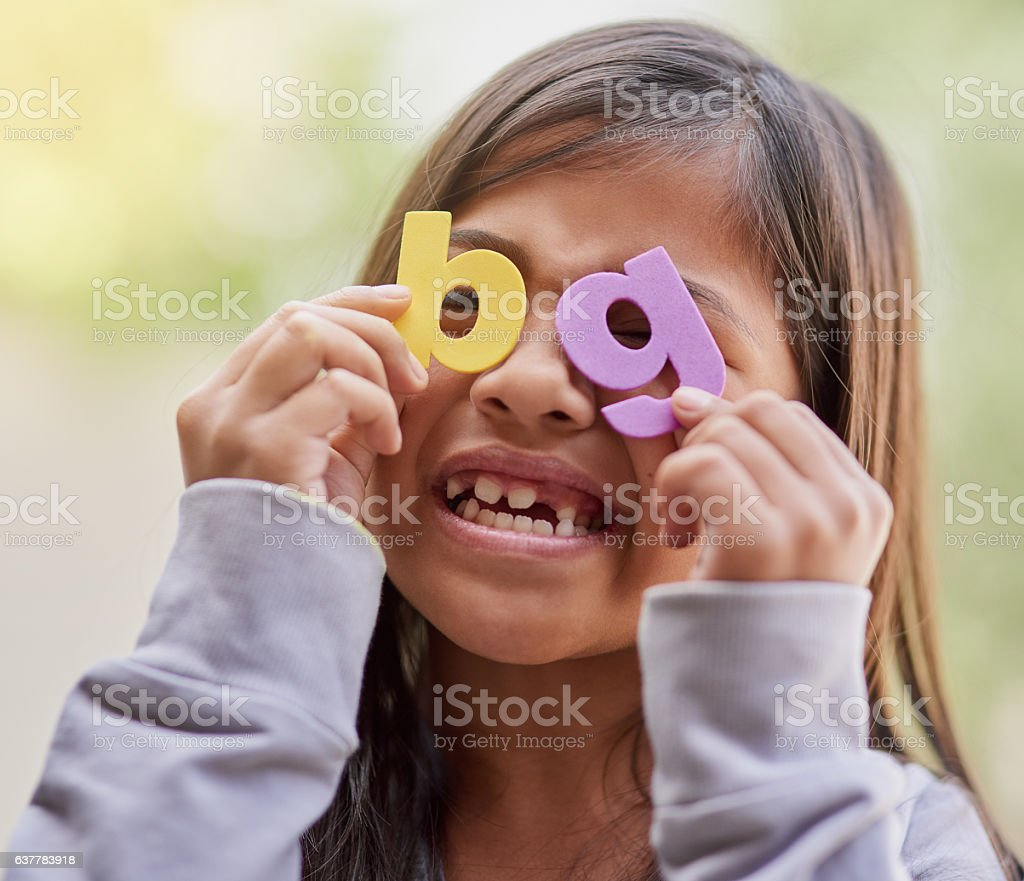 Life is all fun and games when you're a kid stock photo